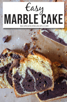 Slices of vanilla and chocolate marble cake stacked with text overlay