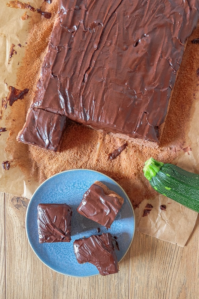 dark squares of chocolate zucchini cake on plate from above