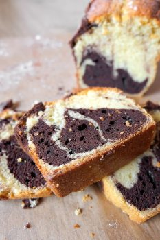 slice of marble cake stacked on slices with cake behind