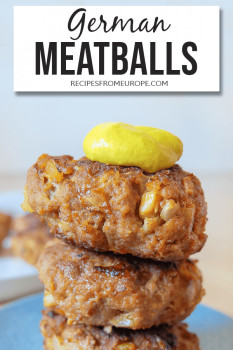 Stack of meatballs with mustard on blue plate and text overlay for pinterest