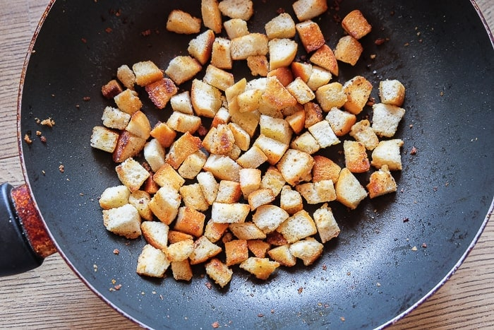 fried bread croutons in a frying pan