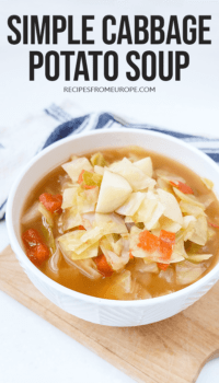 Photo of cabbage potato soup in bowl with text overlay for Pinterest