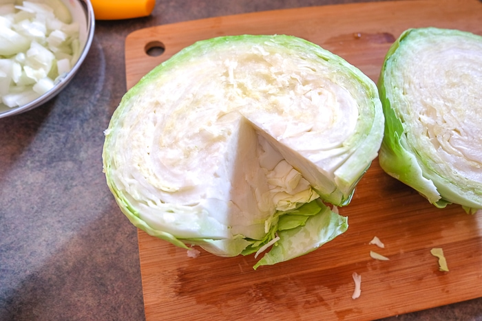 green cabbage with core removed on cutting board