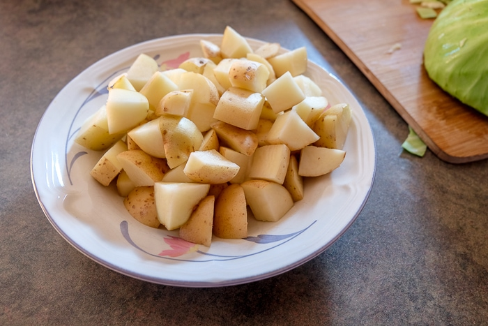 cubed pieces of potatoes in bowl on counter