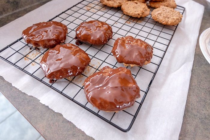 cooling rack with german gingerbread cookies with chocolate topping