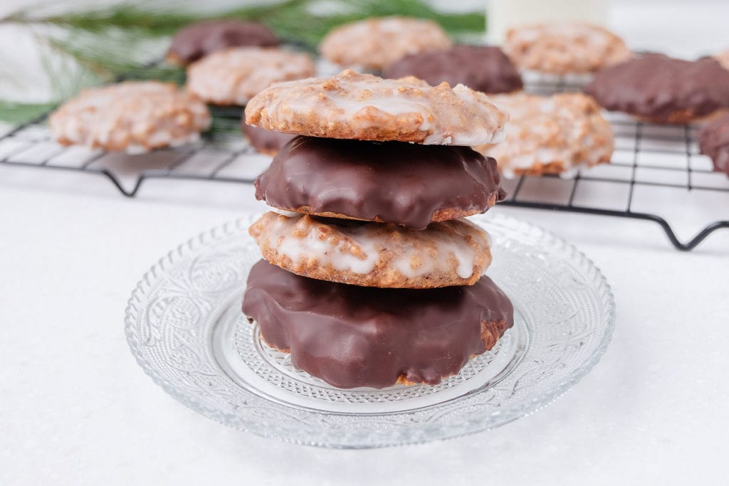 stack of german gingerbread cookies on plate with lebkuchen behind