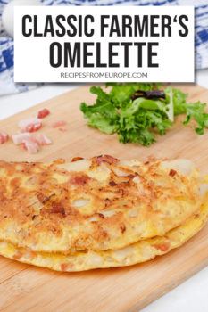 Photo of omelette on wooden platter with food props in background and text overlay for Pinterest