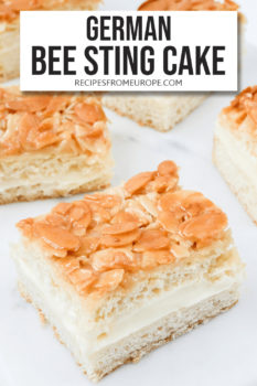 Photo of slices of bee sting cake on marble platter with text overlay for Pinterest