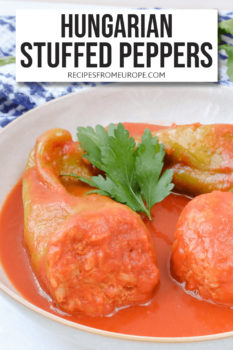 Stuffed peppers with tomato sauce in bowl and text overlay for Pinterest