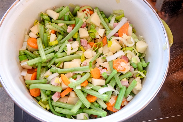 vegetables and ham in large soup pot without broth