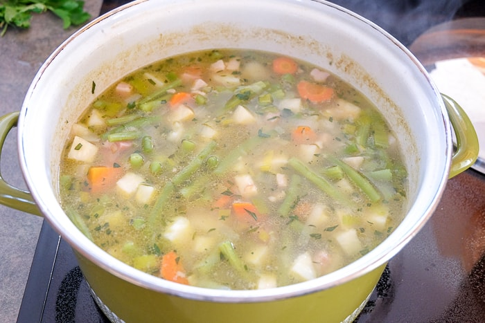 german green bean soup cooked in large green soup pot