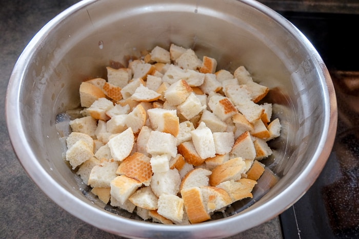soft bread pieces on silver mixing bowl on counter