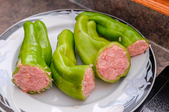 raw green hungarian stuffed peppers on plate