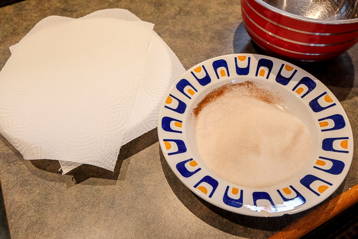two bowls with sugar and paper towel on kitchen counter