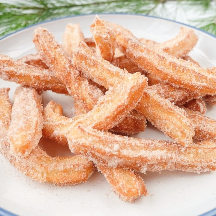spanish churros on blue and white plate