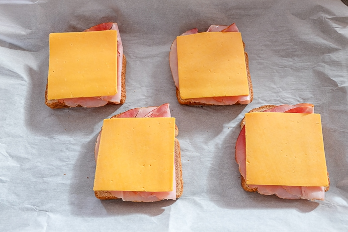 slices of cheese on toast on parchment paper