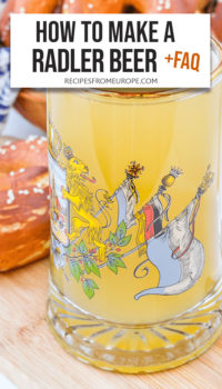 """Photo of yellow radler beer in beer glass with bavarian and german flag and text overlay saying """"how to make a radler beer + faq"""""""