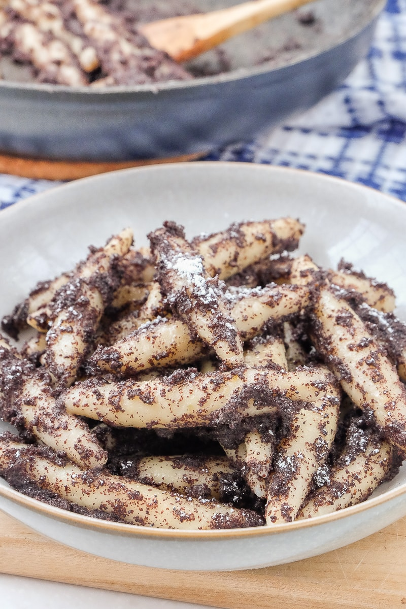 austrian Mohnnudeln in poppy seeds and sugar in bowl