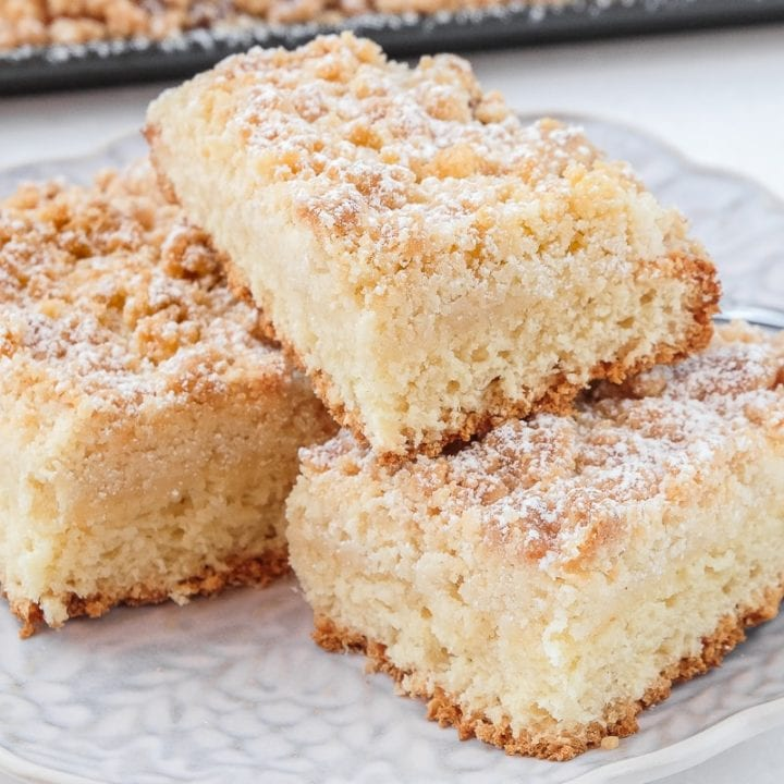 german crumb cake pieces stacked on plate