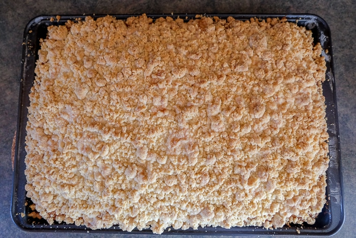 cooked german crumb cake in pan on counter top