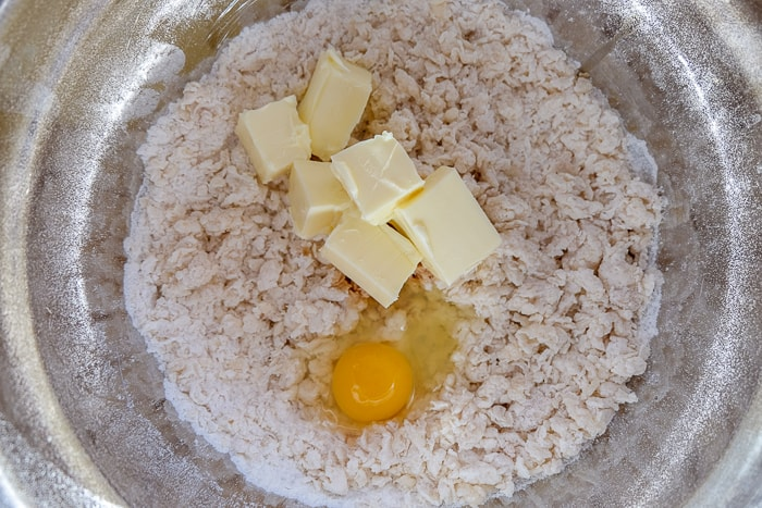 crumb cake dough with butter and egg in silver mixing bowl