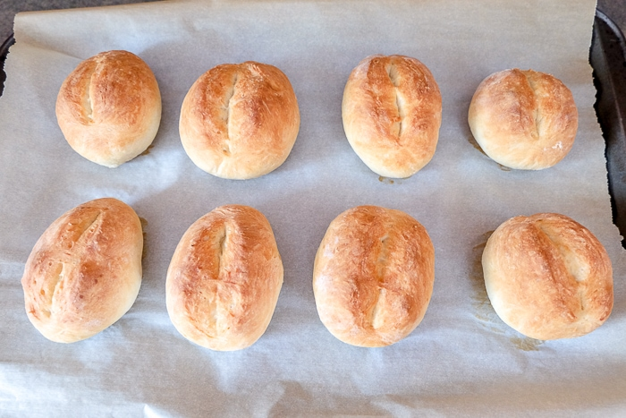 baked german bread rolls on parchment paper