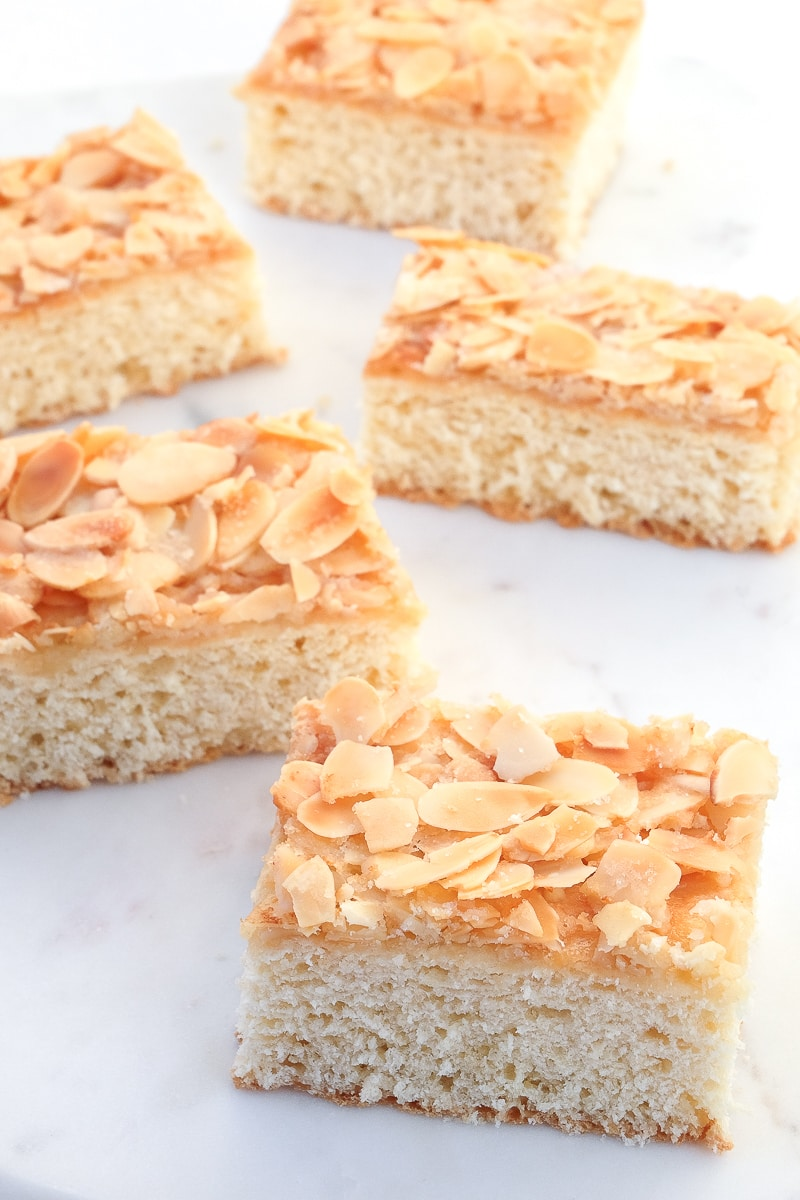 slices of german butter cake with almonds and sugar on white platter