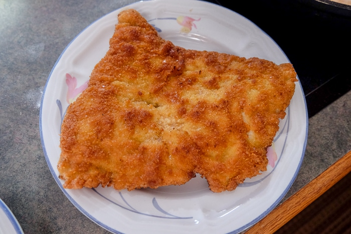 piece of cooked german schnitzel on plate on counter