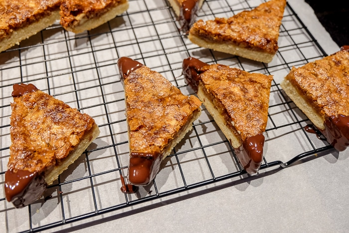nussecken on cooling tray with corners dipped in chocolate