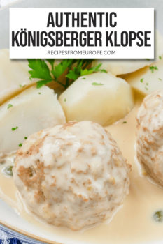 """Boiled meatball with creamy sauce on top and boiled potatoes in bowl plus text overlay saying """"authentic Königsberger Klopse"""""""