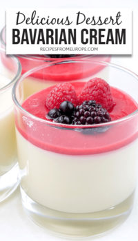 """Bavarian cream in glass with pureed fruit and berries on top plus text overlay saying """"delicious dessert Bavarian cream"""""""