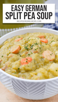 """Split pea soup with pieces of sausage, carrots, potatoes and chopped parsley in white bowl with text overlay saying """"easy german split pea soup"""""""