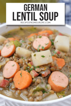 """brown lentil soup with carrots, sausages and potatoes in white bowl with text overlay at the top saying """"german lentil soup"""""""