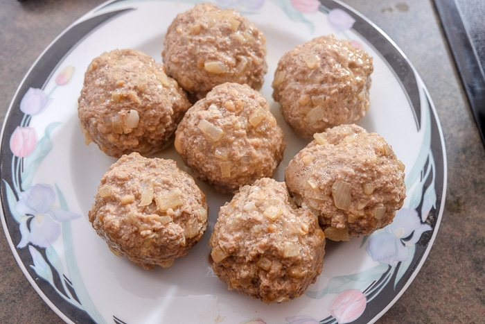 cooked german meatballs on plate on counter