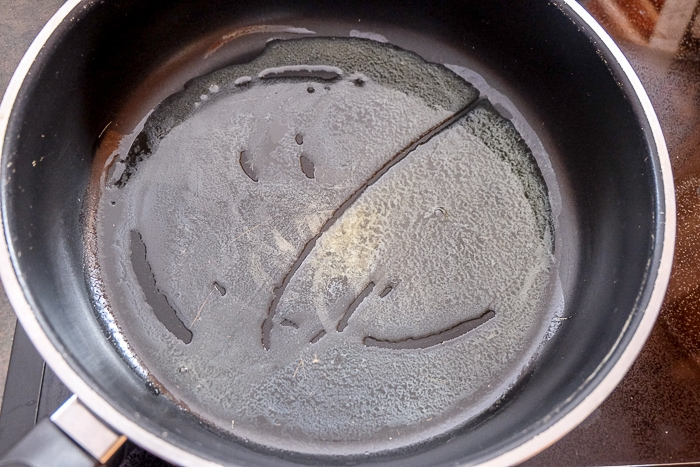 melted butter in large sauce pan on stove top