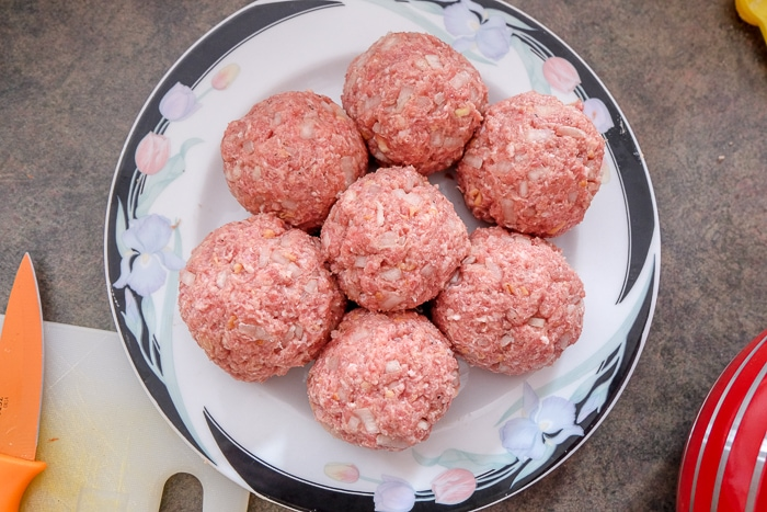 raw german meatballs on plate on counter