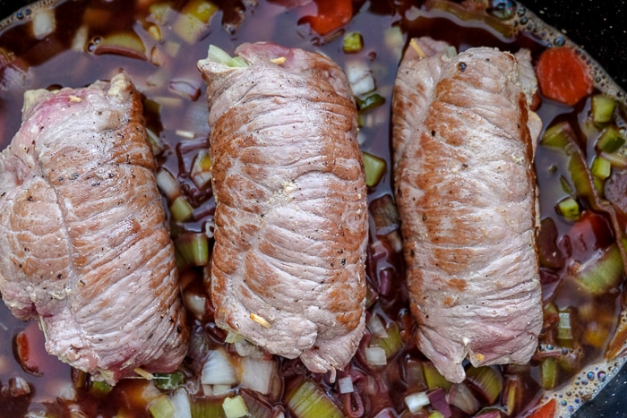 seared beef rouladen on bed of vegetables