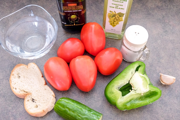 raw vegetables and vinegar on counter with spices