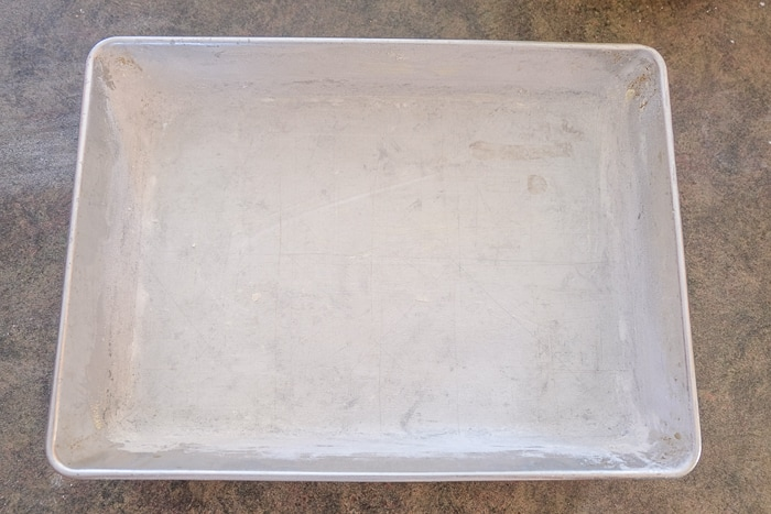 silver baking pan lined with butter and flour