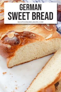 """braided bread with sliced almonds on top end cut off and slices in the front plus text overlay saying """"German sweet bread"""""""