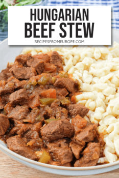 """cooked beef cubes in sauce in bowl with egg noodles and text overlay saying """"Hungarian beef stew"""""""
