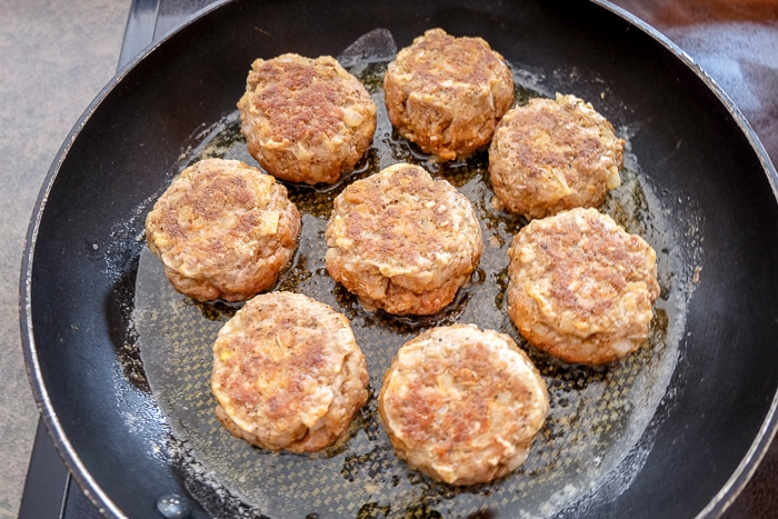 fried meatballs in black frying pan on stove top