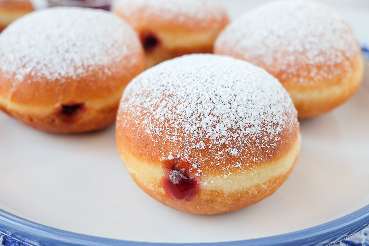 krapfen jelly filled donuts on blue and white plate
