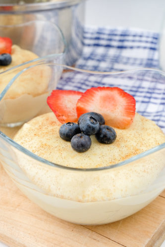 semolina pudding in clear glass bowl with berries on top