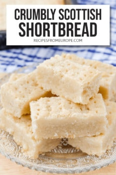 """shortbread fingers with fork holes stacked on clear plate with text overlay saying """"crumbly scottish shortbread"""""""