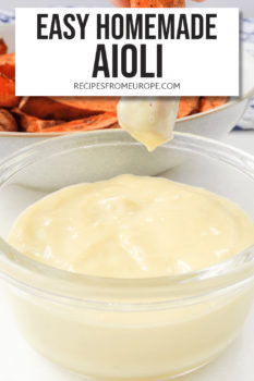 """Sweet potato fry dipped into clear jar with aioli and text overlay saying """"easy homemade aioli"""""""