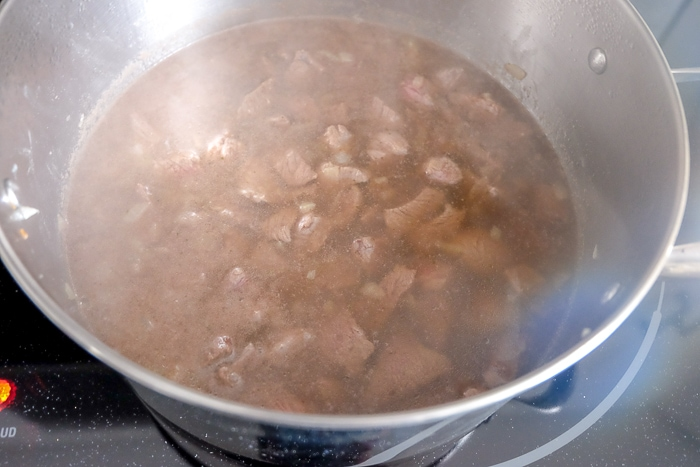 hungarian goulash soup in silver pot on stove
